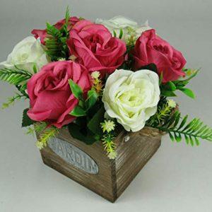 Silk flower cerise roses in wooden Jardin pot