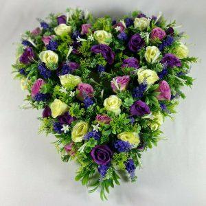 Large purple open heart artificial flower grave wreath